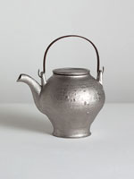 platinum teapot with iron handle