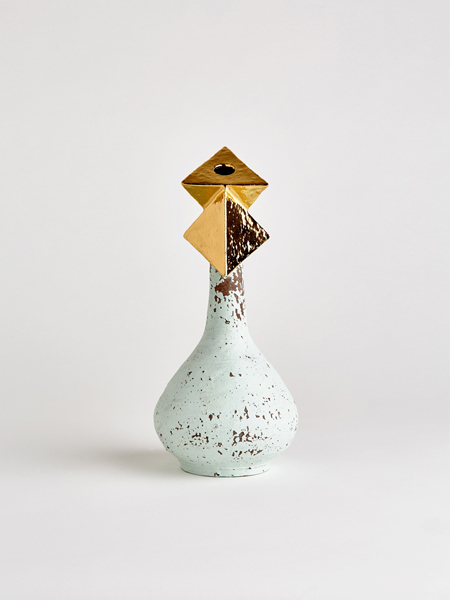 gold pyramid vase